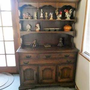 Lot # 34- Vintage wooden dining hutch with all the contents included