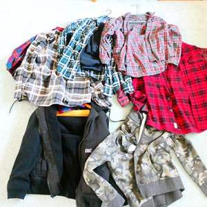 Lot # 82- Mens (M/L) Flannels, Hurley coat, and 19 shirts & contents of closet