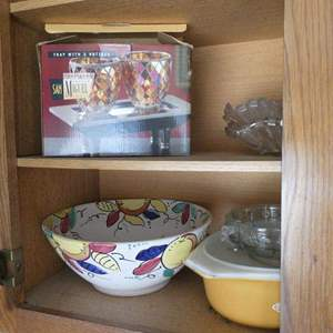 Lot # 219- Cabinet of kitchen JOY!  Napkin holders, bowls, and more