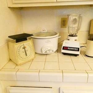 Lot # 343- Food scale, Rival crockpot, vintage Osterizer, vintage braun coffee grinder