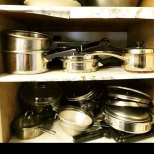 Lot # 346- Lots of pots and pans! Take a look! Treasures may await! 2 shelves
