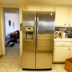 Lot # 348- GE Profile, stainless steel side by side fridge