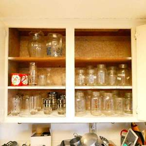 Lot # 350- Assorted glassware, glass pitchers, and mason jars- entire cupboard