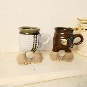 Lot # 351- Two vintage footware people, stoneware mugs/ Misc. kitchen decor