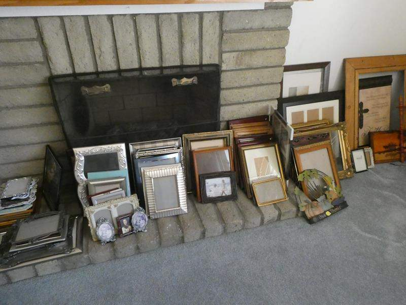 Lot # 19- Lots and Lots of frames and wall hangings (some new) (main image)