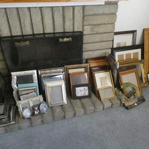 Lot # 19- Lots and Lots of frames and wall hangings (some new)