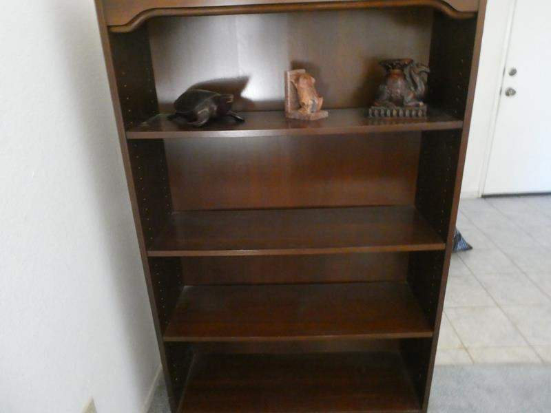 Lot # 21- Solid Wood sturdy bookshelf with figurines (main image)