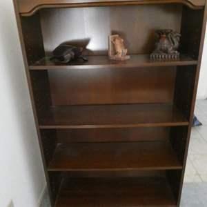 Lot # 21- Solid Wood sturdy bookshelf with figurines