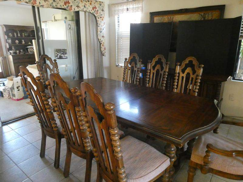 Lot # 29- Vintage wooden dining table set with 8 chairs. (main image)