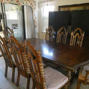 Lot # 29- Vintage wooden dining table set with 8 chairs.