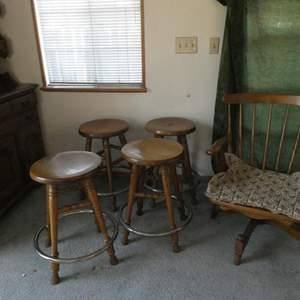 Lot # 35- Four vintage swivel oak barstools, swivel rocking chair, end table