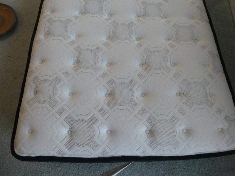 Lot # 36- Twin Costco mattress (new) & metal wheel bed frame  (main image)