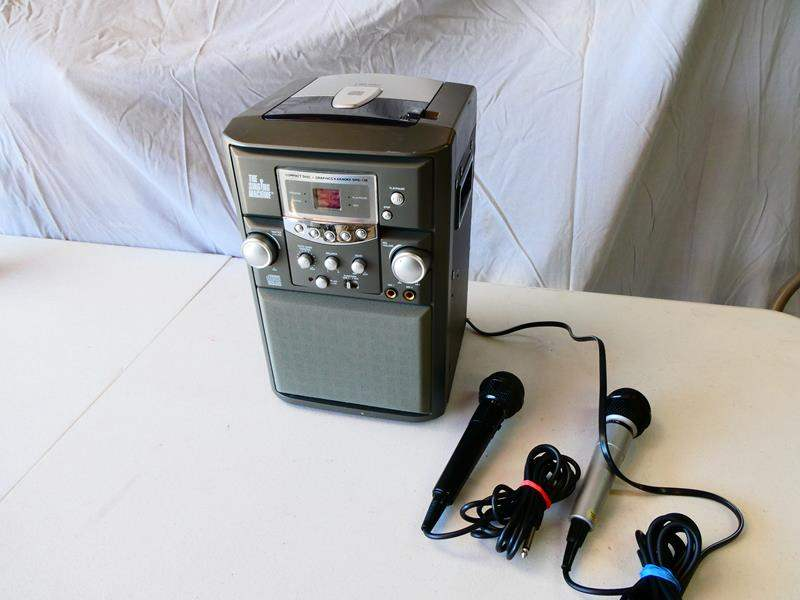"""Lot # 192-Karaoke time! """"The Singing machine"""", CD player with microphones (main image)"""