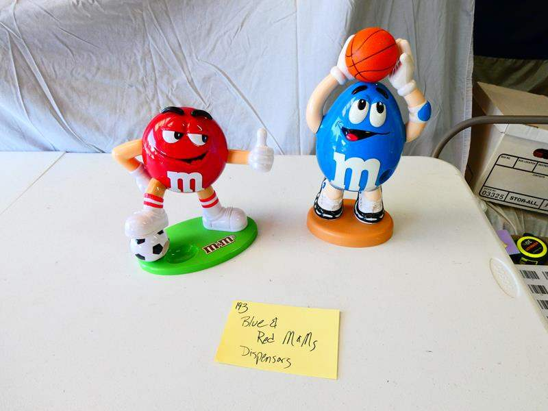Lot # 193- Collectible Blue and red M & M dispensers (main image)