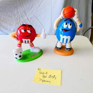 Lot # 193- Collectible Blue and red M & M dispensers