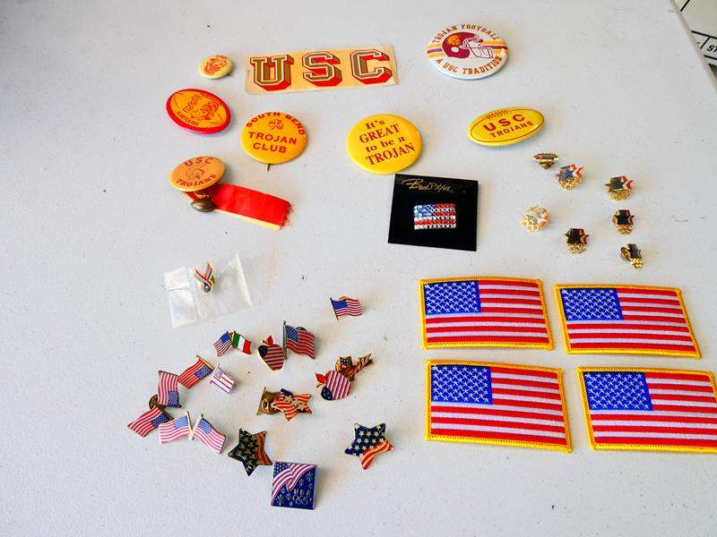 Lot # 199- Collectible pin Collection: USC and USA Olympic pins/ USA patches (main image)