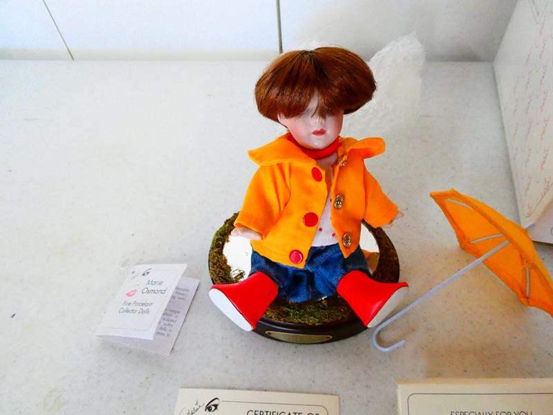"Lot # 202- Marie Osmond fine porcelain 4"" doll, hand numbered, original (main image)"