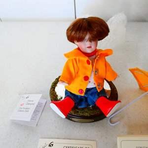 "Lot # 202- Marie Osmond fine porcelain 4"" doll, hand numbered, original"