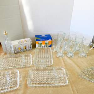 Lot # 205- Crystal/ glass serving trays/ 8 Princess house mugs/ Avon collector bottle and more