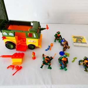 Lot # 27-Collectable Teenage Mutant Ninja Turtles/ Toy van/ action figurines and more