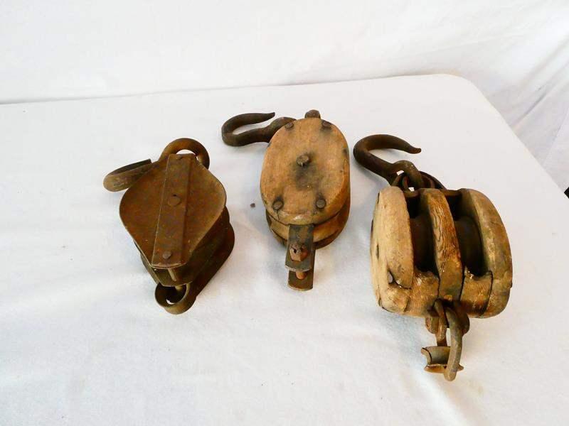 Lot # 51-Three vintage pulleys (main image)