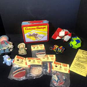 """Lot # 22-Vintage toys: 1998 """"Rare"""" Curious George tin lunch box (sealed package), Holly Hobby doll, and more"""