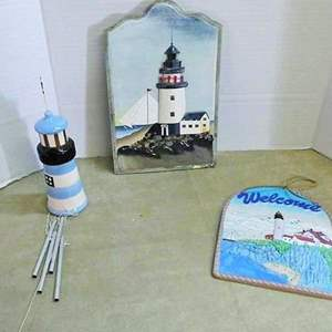 Lot # 220- Light house décor/ Wind chime and wall hangers