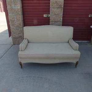Lot # 251- Vintage beige love seat, excellent condition!