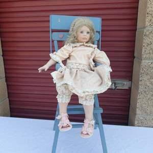 """Lot # 254-Porcelain doll (The Doll Artworks """"MB"""")& Vintage highchair"""