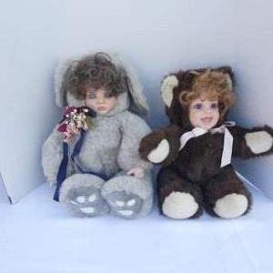 Lot # 255-Porcelain baby girl doll face in Teddy Bear outfit. 2!