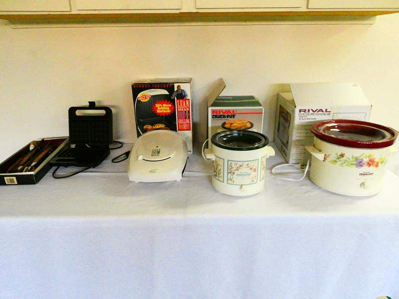 Lot # 191-Two crock-pots, lean mean grilling machine, waffle maker and BBQ tools (main image)