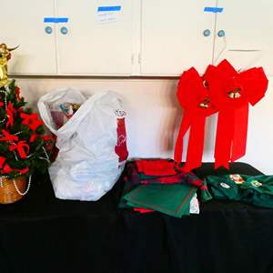 Auction Thumbnail for: Lot # 202-Mini Christmas tree, décor, wrapping, paper, table set, bath towels, bows