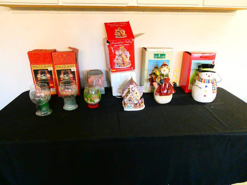 Lot # 206-Christmas décor! Three Christmas candles, sugar Plum Valley, glowing gingerbread house, etc. (main image)
