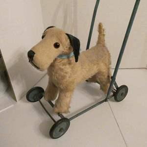 """Lot # 9-Antique dog """"Walker"""" toy on wheels"""