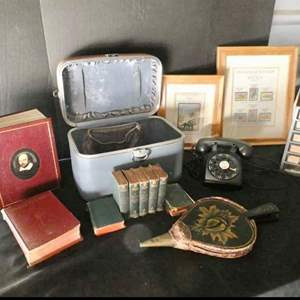 Lot # 56- Vintage collector items: Rotary phone, Shakespeare books, Bellow, Stamps, vintage suitcase, case of jewelry