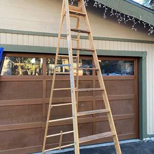 Lot # 306- 10 foot wood ladder (excellent condition)