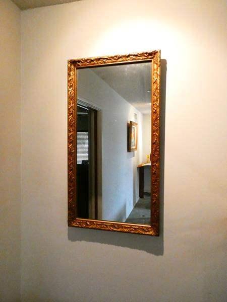Lot # 202- Vintage ornate wall mirror (main image)