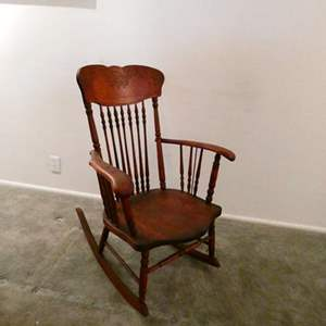 Lot # 207- Antique rocking chair- great condition