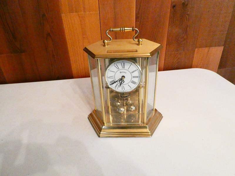 """Lot # 216- """"Bulova"""" clock 8.5"""" tall (main image)"""
