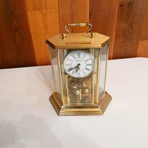"""Lot # 216- """"Bulova"""" clock 8.5"""" tall"""