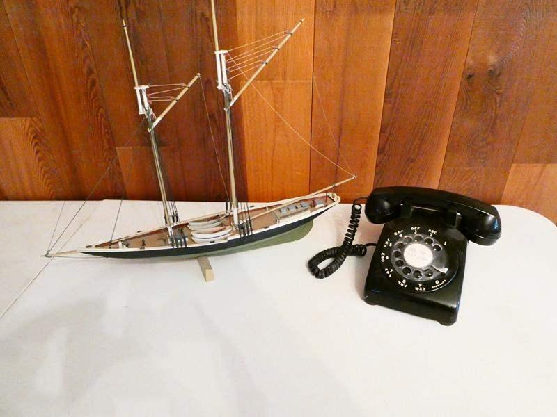 Lot # 219-Vintage model ship and rotary phone (main image)