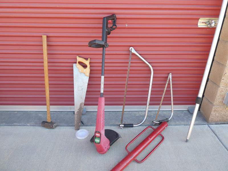 """Lot # 33-Toro 12"""" Grass whip, Mr. Long arm extension pole, 3 saws, sledge hammer, post hole driver (main image)"""