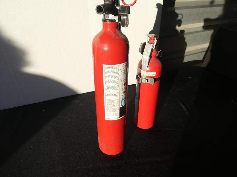 Lot # 63- Two Sears fire extinguishers: 1 med/large, 1 small (main image)