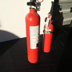 Lot # 63- Two Sears fire extinguishers: 1 med/large, 1 small