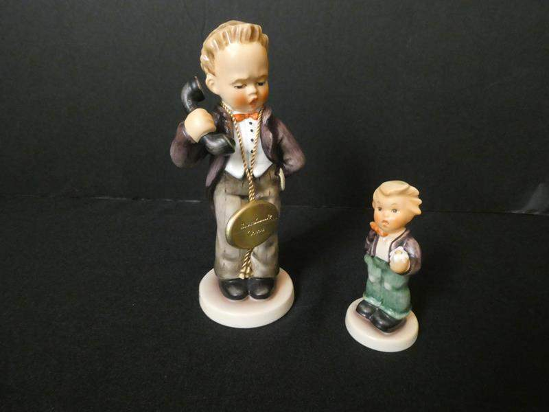 """Lot # 7- Collectible Goebel Hummel's, Germany: """"A flower for you"""", 6 1/2 inch """"Boy on Telephone"""" (main image)"""