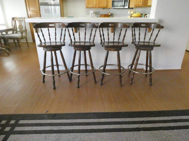 Lot # 106- Four wood barstools- Swivel- great condition (main image)