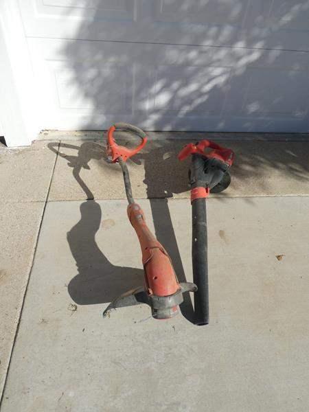 """Lot # 143- """"Grass Hog"""" Grass whip, black & Decker leaf blower (main image)"""