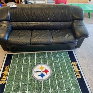 Lot # 102 -Black Leather Couch and Steelers rug