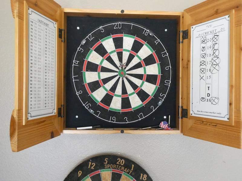 Lot # 112 - Rush Creek Dartboard with Wooden Case plus extra dart board (main image)