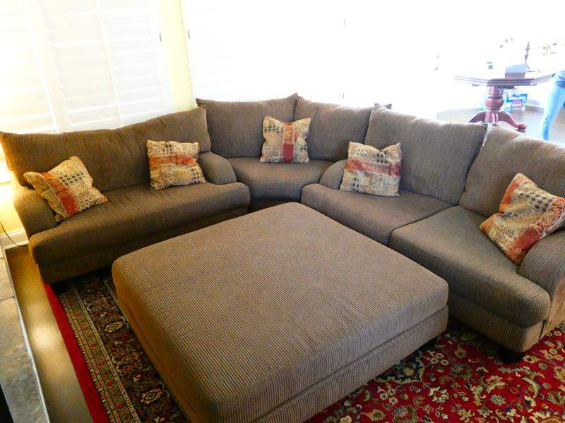 Lot #27- 3 piece sectional couch with large ottoman (main image)